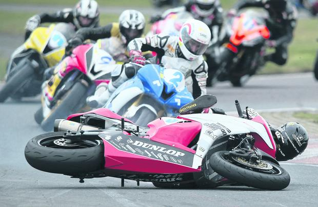Marshall Neill bites the dust during the Superbike race at Easter Monday short circuit races today at Kirkistown