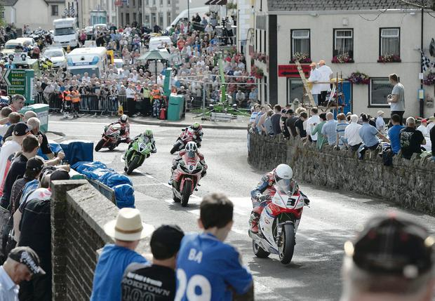 Crowd pleaser: Michael Dunlop scorches through the packed village of Armoy on his way to Superbike victory on Saturday. Pic: Pacemaker