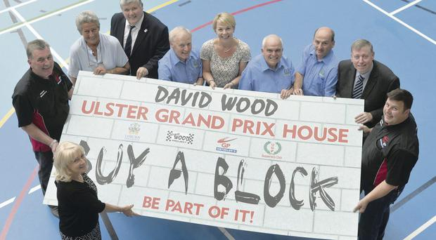 Chip off the old block: Launching the 'Buy a Block' campaign in Lisburn last night for the reconstruction of Ulster Grand Prix House at Dundrod are Lee Wood, Robert Graham, Sally Best, Robert McKnight, Des Stewart, Sharon Courtney, Andy Pinkerton, Paul McGovern, Councillor Paul Porter and James Courtney