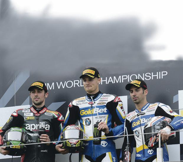 Podium joy: Eugene Laverty (left), winner Chaz Davies (centre) and Marco Melandri