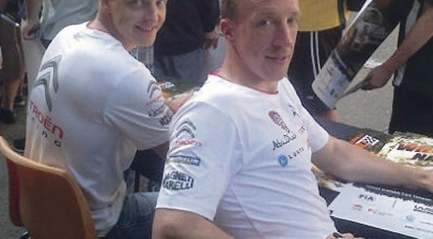 Signing up: Kris Meeke joins Citroen team leader Mikko Hirvonen for an autograph signing session at Coffs Harbour