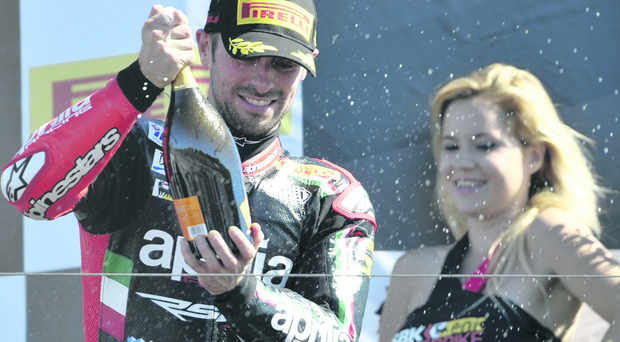 Eugene Laverty celebrates on the podium after his recent race success at Laguna