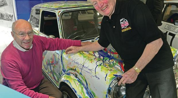 Paddy Hopkirk (right) and Terry Harryman, who won the Monte Carlo Rally alongside Ari Vatanen in 1985, add their signatures to the Neil Shawcross Art Mini which will auctioned at the Hopkirk Gala Dinner on February 22