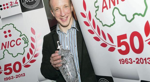 Rally driver Kris Meeke proudly shows off the 2013 Northern Ireland Motorsport Award