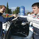 Acropolis Rally winner Craig Breen (right) is congratulated by his Peugeot team-mate Kevin Abbring