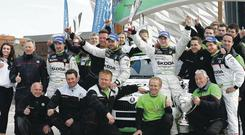 Circuit winners Esapekka Lappi and Janne Ferm from Finland celebrate with their Skoda team at the finish