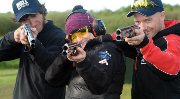 All fired up: (from left) riders Guy Martin, Maria Costello and Keith Amor get in some clay pigeon shooting practice before taking aim at North West