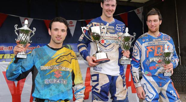 A real handful: Graeme Irwin (left), Gary Gibson (centre) and Richard Bird (right) celebrate with their trophies after the race