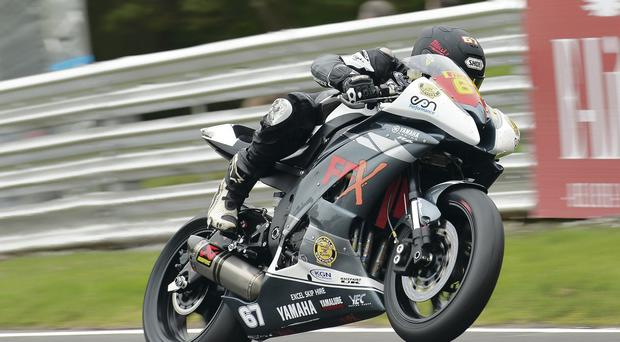 Wheely happy: Jordanstown's Andrew Reid on his way to victory in the National Superstock 600cc race at Donington Park
