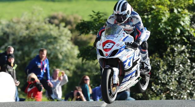 Wheely good: Michael Dunlop (BMW/Hawk Racing) in action during the opening practice session of the Isle of Man TT