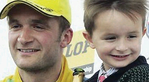 Birthday boy: Colin Turkington and son Lewis on the podium