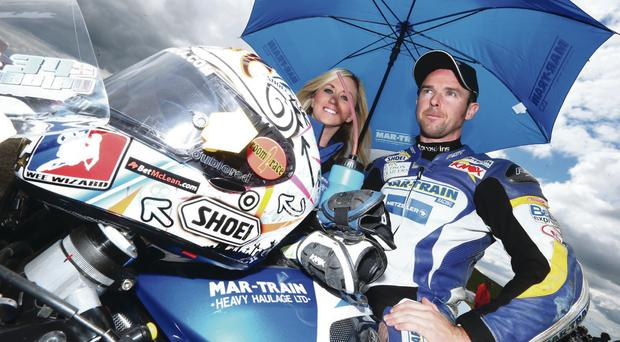 Brolly good show: Alastair Seeley, pictured with partner Danielle Henry, is back in action at Brands Hatch this weekend