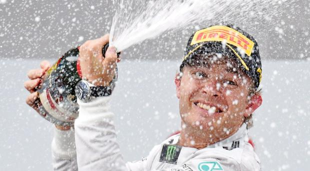 Champagne moment: Nico Rosberg celebrates his lights to flag victory in the German Grand Prix