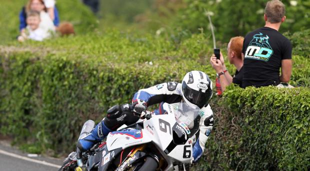 Drive to succeed: Michael Dunlop roars past in the Senior TT race on the Isle of Man back in June