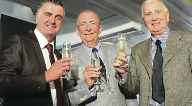 Cheers: Former Ulster F1 stars Martin Donnelly and John Watson raise a glass to the success of 'Hidden Glory' with Plum Tyndall