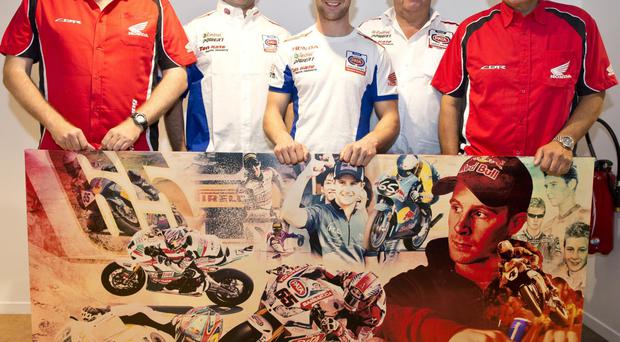 Happy days: Jonathan Rea and members of the Honda team