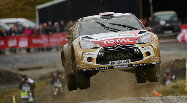 Challenge over: Kris Meeke dropped to sixth place after being forced to nurse two damaged tyres