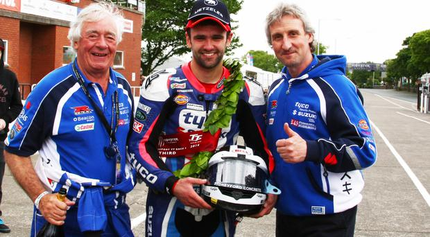All change: William Dunlop with TAS chiefs Hector and Philip Neill