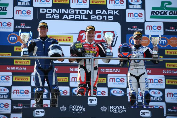 Cups of cheer: local riders Josh Elliott (2nd) and Alastair Seeley (3rd) flank Superstock 1000cc winner Hudson Kennaugh at Donington Park yesterday
