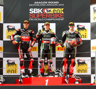 Leading man: Jonathan Rea (centre) tops Race 1 podium after his latest World Superbike victory at Aragon in Spain