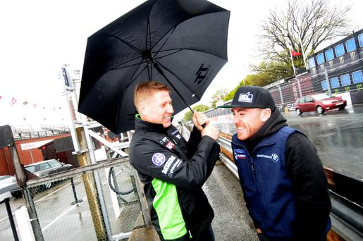Tough conditions: TT racers Gary Johnson and Lee Johnston battle the wind and rain