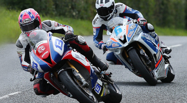 Lee-ding man: Lee Johnston leads William Dunlop on way to Supersport win
