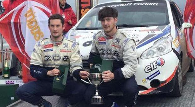Young gun: Jon Armstrong (right) and co-driver Noel O'Sullivan played a starring role in the Todds Leap Ulster Rally