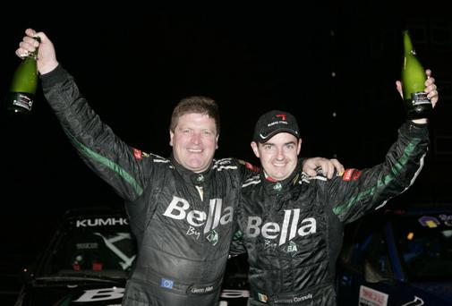 Huge loss: Glenn Allen, pictured with long-time co-driver and friend Damien Connolly, celebrate a success. Allen has passed away aged 47