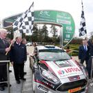 Polish driver Kajetan Kajetanowicz is waved off at Antrim Castle Gardens during the qualifying stage