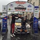 Bubbling over: Tour of the Sperrins winner Marty McCormack is showered in champagne by his co-driving niece Caron