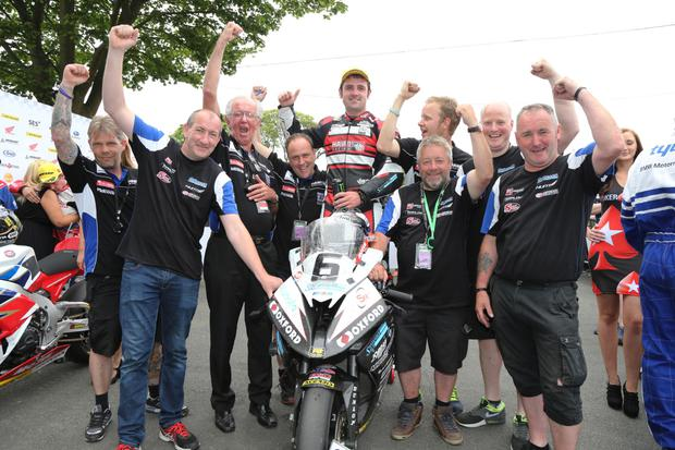 Centre of attention: Michael Dunlop celebrates with his BMW team after clinching victory in the Senior race at the Isle of Man TT