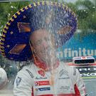 Champagne moment: Kris Meeke celebrates his big win