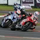 Tight battle: Glenn Irwin leads Alastair Seeley en route to his Superbike victory at the North West 200 on Saturday