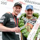Twin team: Supertwin race winner Michael Rutter along with team boss Ryan Farquhar at the NW200 on Saturday