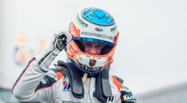 Huge talent: Daniel Harper celebrates his success in becoming the youngest ever winner of the Carrera Cup