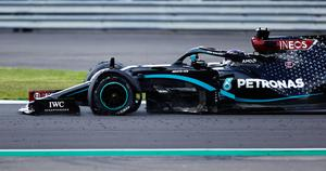Pressure point: Lewis Hamilton negotiates the final lap with a punctured tyre