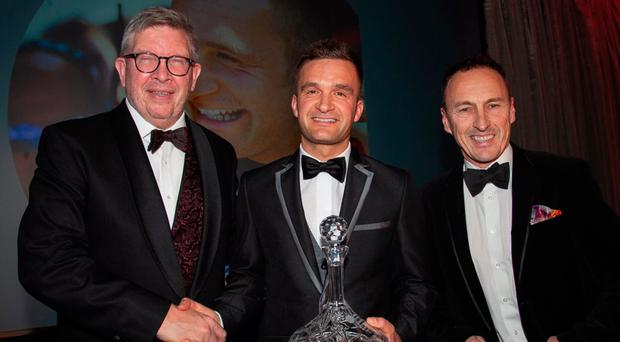 Tour de force: Portadown driver Colin Turkington, centre, was recognised for his record-equalling fourth British Touring car championship when he received the Outstanding Achievement award from F1 chief, Ross Brawn (left), guest speaker at the 25th anniversary Celebration of Motorsport evening at the Culloden Hotel. Also pictured is organising committee member Jeremy McWilliams, the former MotoGP star turned road racer. The event, hosted and co-organised by UTV's Pamela Ballantine, raised a magnificent £75,000 for the Action Medical Research children's charity