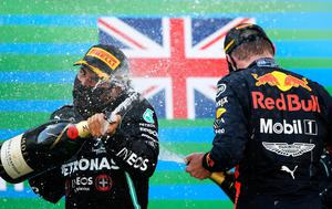 Champagne champ: Race winner Lewis Hamilton and second-placed Max Verstappen