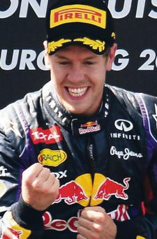 Sebastian Vettel of Germany and Infiniti Red Bull Racing celebrates on the podium after winning the German Grand Prix at the Nuerburgring on July 7, 2013 in Nuerburg, Germany.