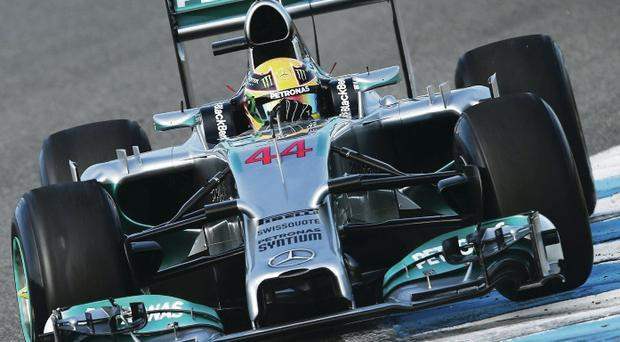 Lewis Hamilton tests the new Mercedes yesterday before a front-wing failure saw him end up in a barrier