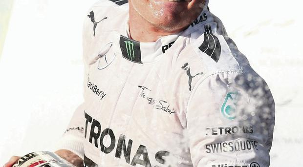 Nico Rosberg celebrates after winning the Australian Grand Prix at Albert Park, Melbourne yesterday