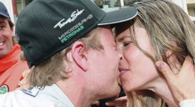 Sealed with a kiss: Nico Rosberg with girlfriend Vivian Sibold