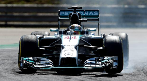 Mercedes driver Lewis Hamilton of Britain steers his car during the free practice session at the Hungarian Formula One Grand Prix in Budapest, Hungary, Friday, July 25, 2014. The Hungarian Formula One Grand Prix will be held on Sunday, July, 27, 2014. (AP Photo/Darko Bandic)