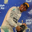 Bubbly time: World champion Lewis Hamilton celebrates victory in Bahrain