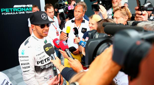 Bumpy road: Lewis Hamilton is well used to the spotlight but he's focused on winning races