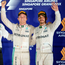 Mixed feelings: Nico Rosberg (left) celebrates his Singapore win, while team-mate Lewis Hamilton had to settle for third
