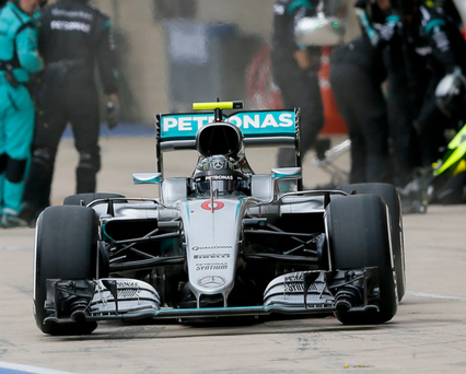 Nico Rosberg leaves the pits after his tyre change