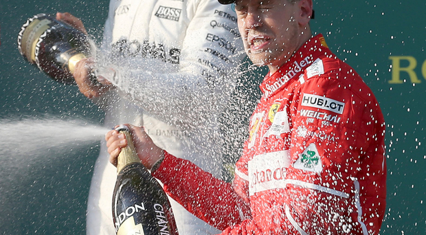 Lovely bubby: Hamilton and winner Vettel on Melbourne podium