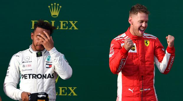 So close: Sebastian Vettel (right) celebrates his win yesterday in front of Lewis Hamilton