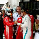 Winning formula: Sebastian Vettel is congratulated by Lewis Hamilton at Australian Grand Prix in Melbourne yesterday